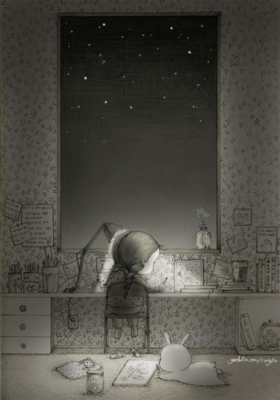 Girl writing against the dying light